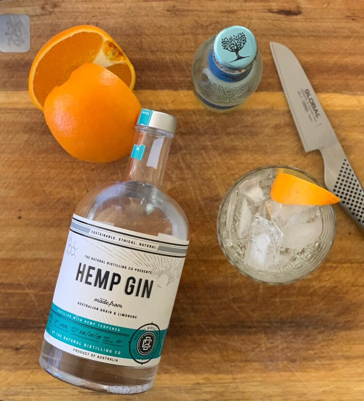 A bottle of hemp gin with oranges