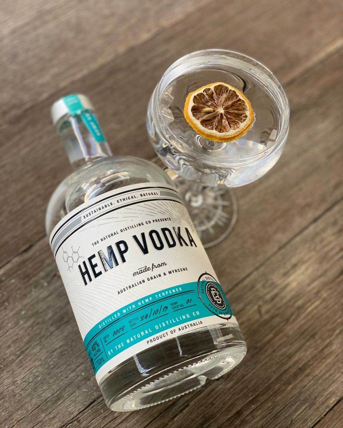 Bottle of hemp vodka with lemon